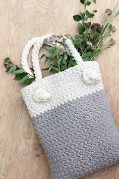 """This free crochet bag pattern for beginners is deceptively simple because it's made from one large rectangle. Neutral colors and a beautiful texture combine in the perfect modern tote or oversized purse. Click for the full """"Suzette"""" stitch tutorial and free bag pattern.   MakeAndDoCrew.com"""