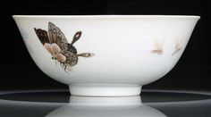 A very fine and rare fencai porcelain bowl with butterflies, flowers and…