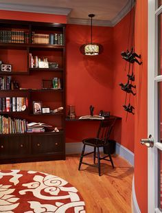 imagine this with chocolate/mahogany walls and a creamy trim... but with book cases in trim color?