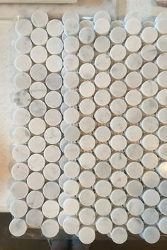 """Polished Bianco Carrara white marble mosaic tile in 1"""" penny rounds pattern. Light white-gray Italian marble with distinctive thin black veining. Sold per tile. 1 Tile = 1 Sq Ft Uses: penny round backsplash tile 