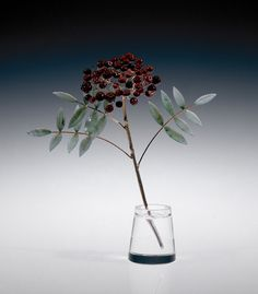 This botanical study is the work of Fabergé's workmaster Henrik Wigström. Crafted from rock crystal, gold, nephrite and purpurine, this rowanberry sprig is similar to one in the British Royal Collection. The choice of purpurine for the berries is very effective. This material was invented in the 17th century and was introduced into Russia by the Imperial Glass Factory. Fabergé resurrected its use and his competitors followed his move.