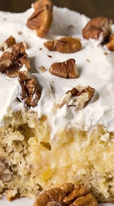 Hummingbird Poke Cake _ with its moist texture & flavoring from pecans, pineapple, & banana, is one of my favorite Southern cakes! Exceptionally delicious! Topped with creamy sweet cream cheese frosting - Spicy Southern Kitchen #dessert #pokecake
