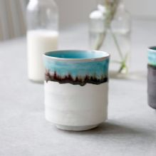 Ceramic cup with turquoise drip glaze