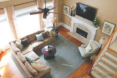 Great Room in beautiful blues and tans. Sectional, chair and oversized rug make a large space cozy