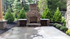 I really love the stonework of this outdoor fireplace. The custom stones of both the floor and the fireplace give it a really unique look. I would love to have a stone fireplace like this in my home, too bad money is tight right now.
