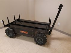 This cart is designed with extendable outriggers to carry sheets of plywood used for matting then retract for hauling to a new site. Electric Utility, Electric Motor, Chain Drive, Plywood, Workplace, Pugs, Pallet, Outdoor Living, Cart