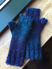 This is an easy fingerless glove I made to solve the problem of trying to work at my computer in a cold office. The pattern continues on the back of the hand, with a flat stockinette stitch on the palm of the hand to reduce bulk on the palm. I have had a lot of requests to make these for people. Fingerless gloves seem to be popular right now, as they can keep hands warm while allowing the wearer to still use a touch screen on their phone or tablet.