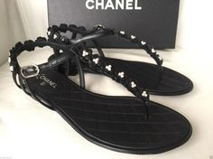 Get the must-have sandals of this season! These Chanel Black 2015 Camellia Flower Leather Flat Pearl Sandals Size US 7 Regular (M, B) are a top 10 member favorite on Tradesy. Pearl Sandals, Chanel Sandals, Chanel Shoes, Flat Sandals, Chanel 2015, Camellia, Chanel Black, Leather Flats, Thongs