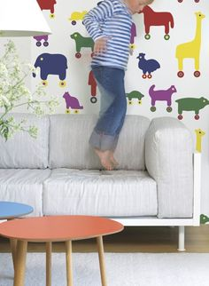 Renowned since the for its bold fabrics, Finnish company Marimekko recently applied its graphic patterns to wallpaper. The comical Karkulaiset displays elephants, zebras, and flamingos — in cowboy boots. Kids Room Wallpaper, Vinyl Wallpaper, Elephant Wallpaper, Marimekko Wallpaper, Childrens Bedroom Decor, Cool Kids Rooms, Luxury Wallpaper, Striped Wallpaper, House Rooms
