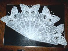 Fan with extended butterflies.