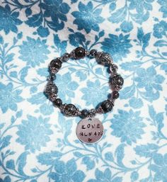 Check out this item in my Etsy shop https://www.etsy.com/listing/261875267/handstamped-jewelry-bracelet-silver