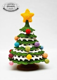 Crochet Christmas tree. Not sold as pattern, only the toy. But take it as a challenge and crochet one from the inspiring image!