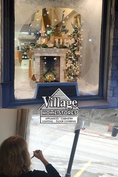 Geneseo Giving Trees window with a pencil tree, faux fireplace, set of wreaths, and swag. Village Home Stores and Durian Builders for GMFC Pencil Trees, Faux Fireplace, Marriage And Family, Epsom Salt, At Home Store, Giving, Snow Globes, Frost, Decor Ideas