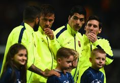 (L-R) Lionel Messi, Luis Suarez and Neymar of Barcelona line up during the UEFA Champions League Round of 16 match between Manchester City and Barcelona at Etihad Stadium on February 24, 2015 in Manchester, United Kingdom.