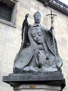A statue of Pope John Paul II with an image of the Virgin of Guadalupe, near the Metropolitan Cathedral in Mexico City; the statue was made entirely of metal keys donated by the Mexican people