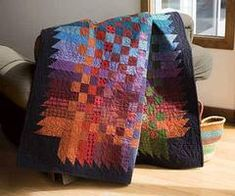 Combine deep-darks with brights in cool blues and purples in this intriguing quilt design. This versatile pieced quilt pattern can be made in seven different sizes--all appealing. Quilt kit has Heather Spence's piecing directions for seven quilt sizes an Flannel Quilts, Plaid Quilt, Fall Quilts, 16 Patch Quilt, Strip Quilts, Quilt Blocks, Jellyroll Quilts, Scrappy Quilts, Batik Quilts