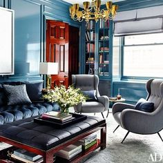 Stephen Gambrel Walls painted in a Sherwin-Williams high-gloss oil serve as the backdrop for a Yayoi Kusama canvas in the library; the sofa is upholstered in a Robert Allen velvet, and the armchairs are vintage Paolo Buffa designs. Le Living, My Living Room, Living Area, Living Spaces, Upper East Side, Architectural Digest, Traditional Office, Home Decoracion, Design Salon
