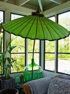 like idea of shade umbrella in sunroom