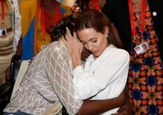 Actress and Special Envoy of the United Nations High Commissioner for Refugees, Angelina Jolie, hugs Neema Namadamu of the Democratic Republ...