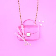 Few things are better than rock candy and a pretty 'n pink purse! #nationalpinkday