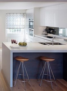 """A mirrored backsplash and touch of color under the counter gives this space some character.  Get this look with Mod's zero VOC finishes in Modello """"Blanco"""" and Thermofoil """"Lausanne E"""" : https://www.modcabinetry.com/thermofoil-mod-cabinetry"""