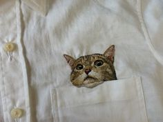 Embroidered peeping cat.