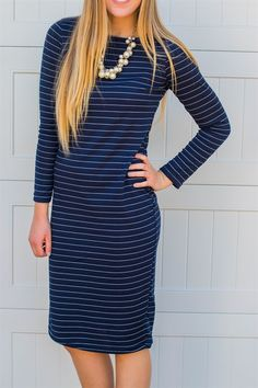 """What's better than our everyday tee dress for fall? Our everyday tee dress with long sleeves! All of the comfort and style of the original with a little extra sleeve length for cooler temps! So comfy and casual for everyday wear, but dress it up with heels and some bling when you need to be """"fancy"""". Pretty easy either way!And because we love our customers, we listened to your feedback and added a plus size option for these little beauties!Sizing S (2-6)M (8-10)L (12-14)XL (14-16)XXL (16-20)"""