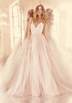 Alabaster tulle ball gown with floral beaded ballet bodice, V-neckline and spaghetti straps with crisscross at back, full tiered tulle skirt.