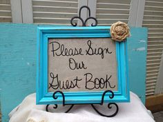 Rustic Turquoise Please Sign Our Guest Book Framed Wedding Sign with Burlap Rosette. $20.00, via Etsy.