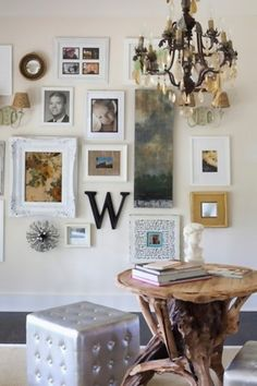 Love the mixture of art and photos and especially the long unframed art piece that is slightly right of center.