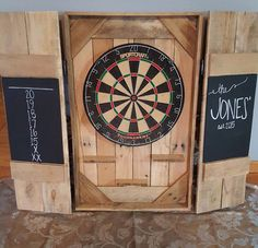 A personal favorite from my Etsy shop https://www.etsy.com/listing/260373637/dartboard-cabinet-dart-board-backboard