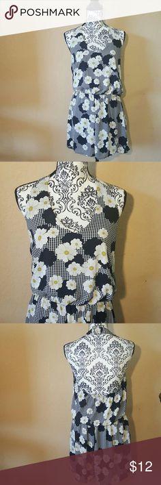 Blk Floral Halter Top Romper Must Have (Brand) Black Floral Halter Top Romper. Very good preloved condition. Shorts
