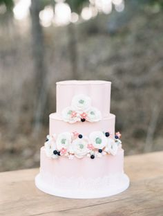 Pink cake with fondant peonies: http://www.stylemepretty.com/canada-weddings/british-columbia/2014/06/25/summer-inspired-wedding-shoot-in-the-okanagan-valley/ | Photography: Christie Graham - http://www.christiegrahamphotography.com/