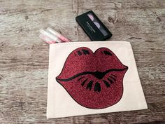 Durable zipper canvas makeup bag with red glitter lips. Lips are designed from a permanent heat transfer material. Glitter Lipstick, Red Glitter, Easy Gifts, Unique Gifts, Handmade Gifts, Customized Gifts, Personalized Gifts, Custom Makeup Bags, Stocking Stuffers For Her