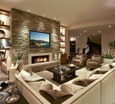 living room with stone fireplace. a sectional, lots of pillows and fireplace, doesn\u0027t get cozier then that! by lmk interiors living room with stone fireplace i