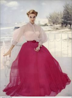 Jean Patchett in sheer pale pink organdy blouse and red pleated nylon tulle skirt by Ceil Chapman, photo by Clifford Coffin in Nassau, Vogue, May 15, 1951