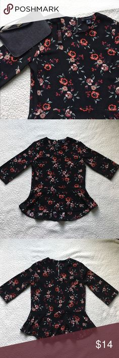 🆕 Floral peplum blouse Dress up any outfit with this cute floral peplum blouse 🌹 Peplum style blouse with 3/4 sleeves. Zipper detail on back. Black with red floral print. US size 2. Bought from Primark at King of Prussia Mall. ❗️Sorry, I do not trade.❗️ Tops Blouses