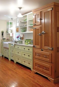 Modern refrigerator disguised as an icebox in an old-house kitchen