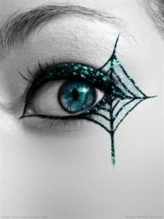 Love the delicacy of glitter, color, spider contact lens pupil, delicacy of line.  Could do without the mascara and lined eye, but it's that time of year, costume tIme!  Pinterest wouldn't let me link to 'inappropriate' URL.