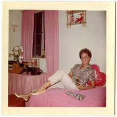 found photo woman in bedroom pink curtains bedspread leopard shirt top blouse white pencil pants hairstyle shoes early to late color vintage fashion style. Note the figurine. Vintage Soul, Retro Vintage, Vintage Photographs, Vintage Photos, Vintage Magazine, Vintage Outfits, Vintage Fashion, Vintage Clothing, Vintage Polaroid