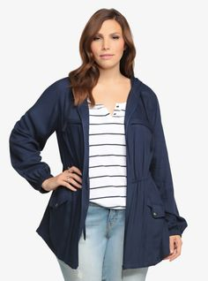"""This lightweight classic is the perfect jacket to have handy for """"in-between"""" weather days. This parka has features you love and need. Hooded back. Drawstring waist. Front pockets. Fashionable and functionable is the way to go.%0A"""
