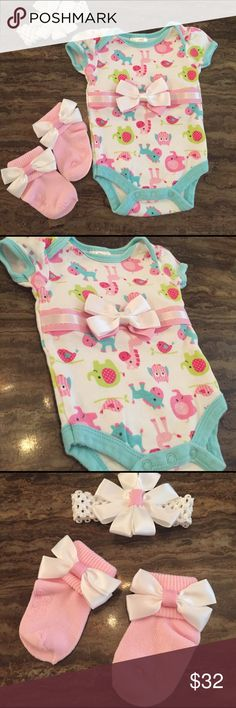 ONEPIECE ANIMALS AND BOWS, socks, headband sz 3 mo This is a boutique item hand made with pink and white ribbons and bows.  There are socks, one piece TEE, and head band with flower like bow.  Cute for photos, outing, being home fri the hospital in, easter or just to be sure in .  More hand made out fit sets to come.  New.  Thanks for looking.  See photos for more details.  I have other baby set listings too. Makes a great baby shower gift.  One of a kind. Baby gear and hand made Matching…