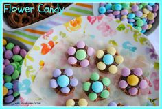 Hershey Kisses, pretzels, and m  ms make very cute and yummy spring flowers!