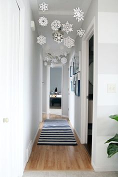 Snowflakes. Fun idea for hall by K and A's rooms.