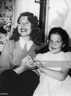 The American actress Rita HAYWORTH with her daughter Rebecca, whom she had with Orson WELLES, in their chalet in Gstaad, Switzerland, on March 24, 1950. Description from gettyimages.com. I searched for this on bing.com/images