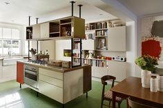The kitchen, with green marmoleum flooring. Photographed by Darren Chung