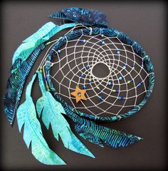 Batik Dream Catcher- Firefly - fabric feathers - upcycled - boho - turquoise - navy blue - green- vegan. $36.00, via Etsy.