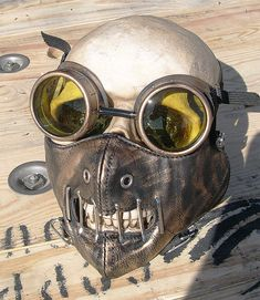 Excellent gift for that special someone with eclectic, unique, and maybe even somewhat eccentric tastes. This listing is for a faux leather Hannibal Lecter mask with elastic straps and a matching set of goggles. The goggles 2 50MM lenses are interchangeable.. Lens colors are: blue, clear,