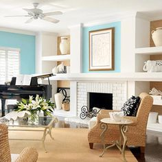 Seaside setting.  Bright aqua walls accent white woodwork. Rattan furnishing plays up a seaside theme. Setting furniture at an angle keeps things casual--appropriate for a shore setting.