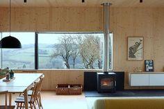 The perfect rainy day spot . Photo: Simon Maxwell . #homebuilding #selfbuild #rain #cosy #livingroom #livingroomdecor #luxuryliving #countryliving #view #tree #woodcladding #wood #trees #interior #interiordesign #views #scandinaviandesign #hyggelife #tranquil #home #modernrustic #idea #instainspo #inspiration #countryside #midcenturymodern #myhomevibes #tuesday #calm #window
